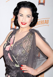 Dita Von Teese showed off her divine moon manicure in a white-and-red combination.