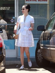 Dita Von Teese opted for white canvas sneakers to pair with her cute dress.
