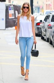 Doutzen chose a free-flowing, sleeveless white blouse for her look while out in NYC.