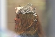 Actress Drew Barrymore spent 5 hours at a hair salon to change her hair color back to blonde in West Hollywood, California on April 29, 2013. While in the salon actress Emily Blunt came in to get her hair done at the same time.