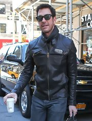 Dylan McDremott was edgy and cool in a black leather motorcycle jacket while grabbing coffee in NYC.