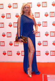 "Jenny shows off her youthful legs in a ""slit up to there"" evening gown."
