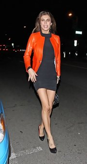 Elisabetta Canalis wore a clingy LBD with her orange leather jacket while out in Hollywood.