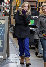 Ella Rae Peck looked casual on the 'Gossip Girl' set in loose blue pants, sheepskin boots and a parka.