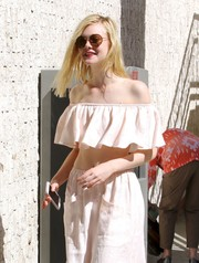Elle Fanning visited a Hollywood studio sporting cool round shades.