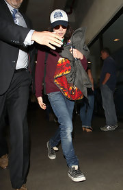 Ellen Page was dressed for comfort at the airport and wearing a pair of gray canvas Converse.