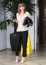 Ellen Pompeo chose black slacks to pair with her casual V-neck while out in Beverly Hills.