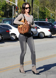 Emily topped off her casual style with ankle wedges booties.