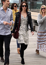 Emily Blunt was spotted strolling in Australia wearing this white crosshatch dress with a moto jacket.