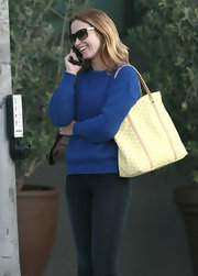 Emily Blunt looked casual yet chic carrying a yellow and white print tote with tan leather trim.
