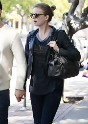 Emily VanCamp opted for a classic leather jacket paired with a screen tee for her casual daytime look while out in LA.
