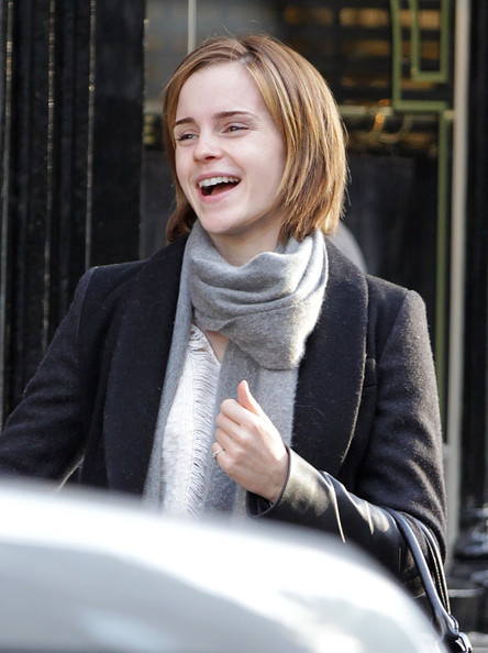 Harry Potter actress Emma Watson spotted with a wad of cash heading into