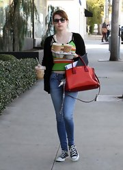 Good thing that's a big Miu Miu! Emma's bag was crammed and overflowing while she made a coffee run for some friends.