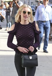Emma Roberts headed out in Beverly Hills carrying a classic black leather purse by Dior.