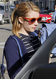 Emma Roberts brightened up her nautical style with a pair of red cateyes.