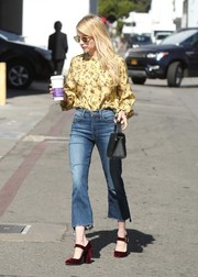 Emma Roberts looked demure up top in a yellow print blouse by Wilfred for Aritzia while out in Beverly Hills.