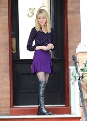 Emma Stone paired this purple mini skirt with a print blouse for a retro-inspired look on the set of 'The Amazing Spider Man 2.'