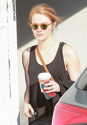 Emma Stone stepped out of her gym wearing a pair of orange-rimmed shades.