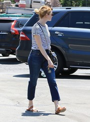 Tan slide sandals completed Emma Stone's off-duty look.