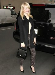 Emma Stone chose these nude and black lace-patterned pants to give her daytime look a fun and flirty vibe.
