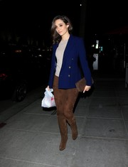 Emmy Rossum teamed her jacket with a pair of brown suede pants.