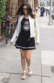 Emmy Rossum styled her casual mini and shirt combo with a patterned white cropped jacket.