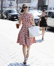 Emmy Rossum made an ultra-feminine statement with this red and white floral frock while out and about in Beverly Hills.
