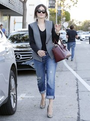 Emmy Rossum smartened her rugged pants with a two-tone blazer by Reese + Riley.