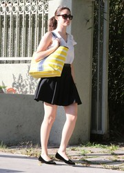 Emmy Rossum perked up her monochrome outfit with a brightly colored striped tote.