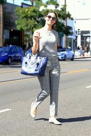 Emmy Rossum went for a monochromatic finish with a pair of gray plaid pants.