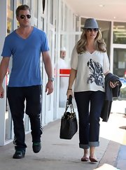 Rebecca donned a casual floral print blouse over jeans while out in West Hollywood with her husband.