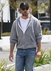 Eric Johnson stepped out looking casual and cool in this gray zip-up hoodie.
