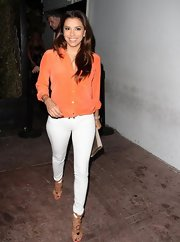 Eva had fun with color when she donned this tangerine button down.