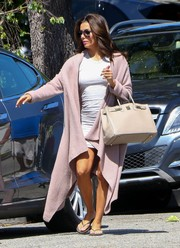 Eva Longoria added drama to her mini dress with a long, draped dusty-pink cardigan.