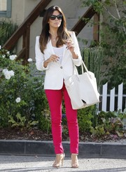 Eva Longoria added a splash of color to her look via a pair of magenta skinnies.