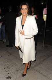 Eva Longoria looked very polished in a chain-embellished white coat by Victoria Beckham as she arrived for 'The Colbert Report.'
