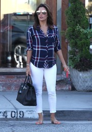 Eva Longoria visited the Ken Paves salon wearing a Rails plaid button-down and white skinny jeans.