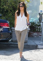 Eva Longoria finished off her look with nude Brian Atwood Temptation sandals.