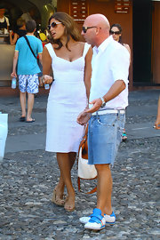 Domenico chatted with Eva Mendes in a cool pair of low top sneakers.