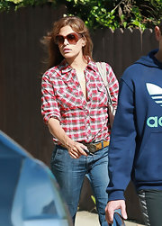 Even a plaid button-down boyfriend shirt can't downplay Eva's singular sexiness.