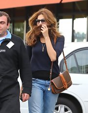 Eva Mendes wore a brown leather shoulder bag while grocery shopping in Los Feliz, California.