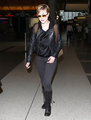 Evan Rachel Wood traveled in style, wearing black skinny jeans paired with black leather lace-up boots.