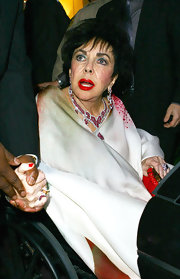 Elizabeth Taylor looked glamorous, as always, with her ruby and diamond chandelier necklace.