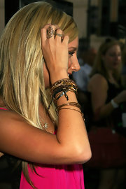 This beautiful gold ring wraps around Ashley's middle finger.