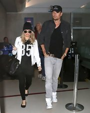 Fergie dressed up her oversized tee with a cool white leather jacket.