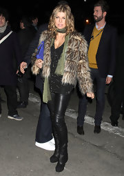 Fergie rocks a pair of leather pants with her eclectic Fashion Week ensemble.