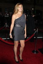 Connie Britton looked fabulous in a pair of black platform pumps. The heels matched a lovely kisslock clutch.