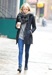 Emma stayed warm in NYC wearing this black toggle coat and chunky scarf.
