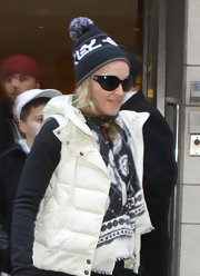 Madonna bundled up in a thick pompom beanie and scarf.