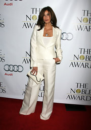 Teri wore a polished white pantsuit with wide legged trousers and flap-closure pockets. She kept her look semi-casual by wearing a simple white tee under her blazer.